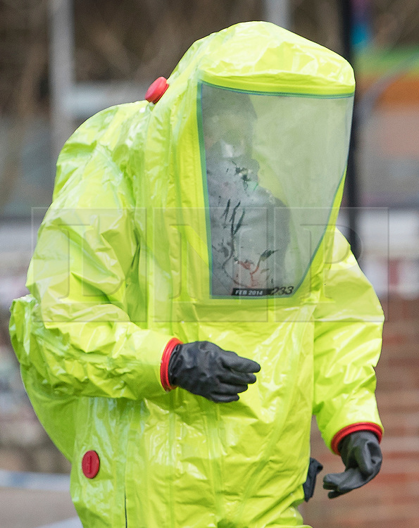 © Licensed to London News Pictures. 08/03/2018. Salisbury, UK. A firefighter in hazardous material suit adjusst a police tent covering a park bench next to The Maltings shopping centre in Salisbury where Former Russian spy Sergei Skripaland his daughter Yulia were found after being poisoned with nerve agent. The couple where found unconscious on bench in Salisbury shopping centre. Authorities continue to investigate. Photo credit: Peter Macdiarmid/LNP