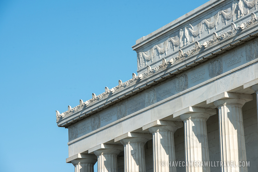 Detail of some of the exterior of the Lincoln Memorial in Washington DC, with the names of the US states etched around the top of the memorial.
