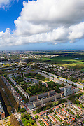Nederland, Zuid-Holland, Leidschendam, 09-05-2013; De Prinsenhof, nieuwbouwwijk uit de jaren zestig, overloopgebied voor Den Haag. Foto richting wijk De Heuvel, skyline Den Haag in de achtergrond. Basiontwerp is rechthoekig hof bestaande uit dubbele ring van woningen (middelhoogbouw) met daarbinnen voorzieningen in het groen. Wederopbouwgebied.<br /> New residential area built in the sixties, overflow area for The Hague. Basic design is rectangular court with a double ring of housing (medium-rise) and green courtyard in the middle. Reconstruction area.<br /> luchtfoto (toeslag op standard tarieven)<br /> aerial photo (additional fee required)<br /> copyright foto/photo Siebe Swart