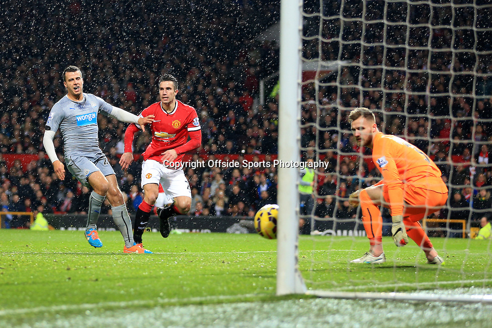 26th December 2014 - Barclays Premier League - Manchester United v Newcastle United - Robin van Persie of Man Utd scores their 3rd goal in the rain - Photo: Simon Stacpoole / Offside.