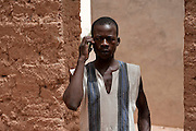 Hoceni, a migrant from Burkina Faso on the phone with his family.