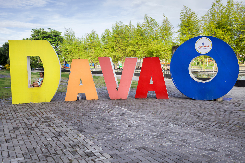 Davao City, Mindanao, Philippines - JUNE 22: A child plays under the Davao sign at Lanang Mall.