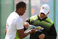Warriors support staff Drikus Saaiman pours water onto Makhaya Ntini of the Warriors hand during the Warriors training session held at St Georges Park in Port Elizabeth on the 16 September 2010..Photo by: Shaun Roy/SPORTZPICS/CLT20