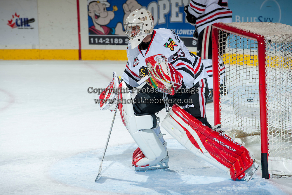 KELOWNA, CANADA - OCTOBER 4:  Jarrod Schamerhorn #33 of the Portland Winterhawks defends the net during warm up at the Kelowna Rockets on October 4, 2013 at Prospera Place in Kelowna, British Columbia, Canada (Photo by Marissa Baecker/Shoot the Breeze) *** Local Caption ***