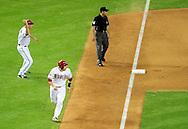 May 19 2011; Phoenix, AZ, USA; Arizona Diamondbacks base runner Miguel Montero (26) runs for home plate as third base coach Matt Williams (9) reacts as pinch hitter Sean Burroughs (not pictured) runs the bases during the sixth inning against the Atlanta Braves at Chase Field. Mandatory Credit: Jennifer Stewart-US PRESSWIRE