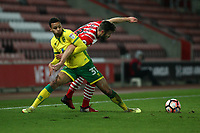 Football - 2016 / 2017 FA Cup - Third Round Replay: Southampton vs. Norwich City<br /> <br /> Josh Murphy of Norwich City tangles with Southampton's Sam McQueen at St Mary's Stadium Southampton England<br /> <br /> COLORSPORTt/SHAUN BOGGUST