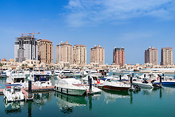 View of marina and apartment buildings at The Pearl luxury new residential property development in Doha Qatar