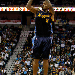 Dec 18, 2009; New Orleans, LA, USA;  Denver Nuggets guard J.R. Smith (5) shoots against the New Orleans Hornets during the second half at the New Orleans Arena. The Hornets defeated the Nuggets 98-92. Mandatory Credit: Derick E. Hingle-US PRESSWIRE
