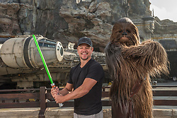 HANDOUT - Matt Damon encounters Chewbacca at the new Star Wars: Galaxy's Edge at Disneyland Park in Anaheim, Los Angeles, CA, USA, on August 5, 2019. Damon who was vacationing with family, met Chewbacca in front of Millennium Falcon: Smugglers Run before taking the controls of the fastest ship in the galaxy. Photo by Joshua Sudock/Disneyland Resort/ABACAPRESS.COM