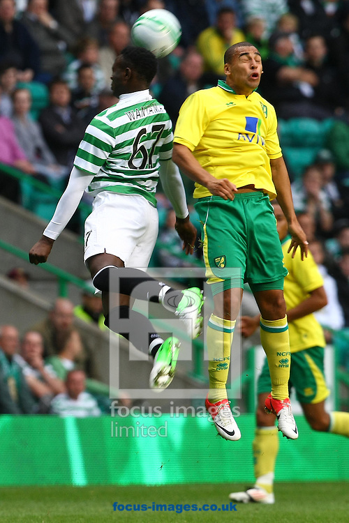 Picture by Paul Chesterton/Focus Images Ltd +44 7904 640267.24/07/2012.James Vaughan of Norwich and Victor Wanyama of Celtic in action during the Friendly match at Celtic Park, Glasgow.