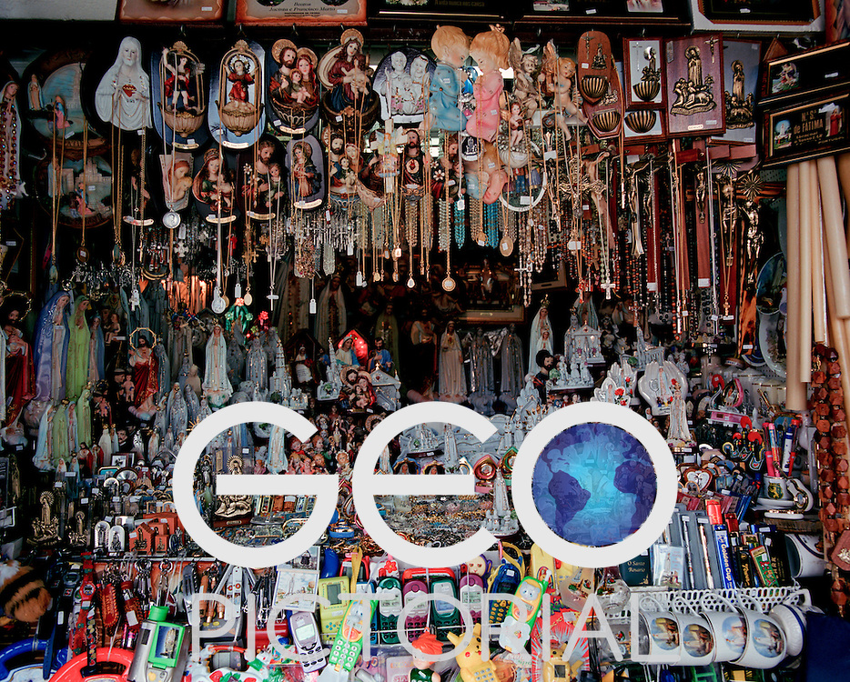A souvenir shop in Fatima filled with religious figurines and trinkets alongside childrens toys and games.