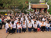 05 APRIL 2012 - HANOI, VIETNAM:   Vietnamese high school students wait for a ceremonial blessing to achieve good grades to start of the Temple of Literature in Hanoi, the capital of Vietnam. The Temple of Literature (Vietnamese: Vn Miu, Hán t) is a temple of Confucius in Hanoi, northern Vietnam. The compound also houses the Imperial Academy (Quc T Giám). The temple also functioned as Vietnam's first university. The temple was first constructed in 1070 under King Lý Nhân Tông and is dedicated to Confucius, sages and scholars.   PHOTO BY JACK KURTZ