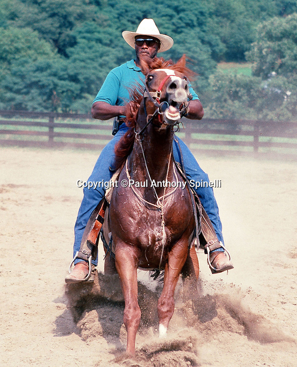 Former NFL Pittsburgh Steelers defensive back Mel Blount rides a horse at the Mel Blount Youth Home on Aug. 30, 1997 in Pittsburgh. (©Paul Anthony Spinelli)