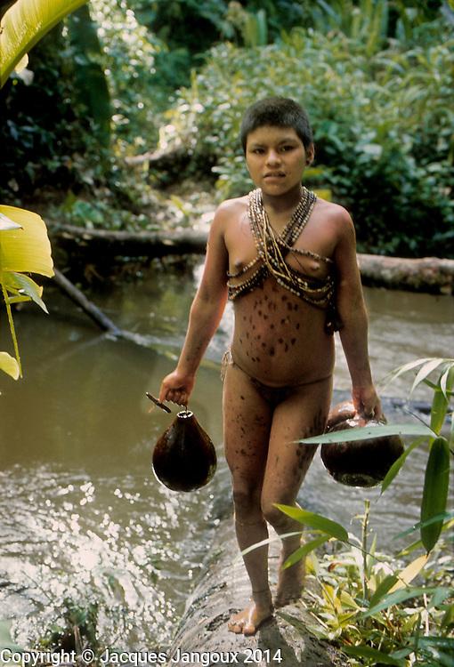 Hoti Indian girl fetching water at stream, Guiana Highlands, Venezuela, South America.
