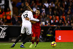 December 8, 2018 - Valencia, Spain - Mouctar Diakhaby of Valencia CF (L) and Andre Silva of Sevilla FC (R)  during spanish La Liga match between Valencia CF v Sevilla FC at Mestalla Stadium on December 8, 2018. (Photo by Jose Miguel Fernandez/NurPhoto) (Credit Image: © Jose Miguel Fernandez/NurPhoto via ZUMA Press)