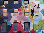 Windows embedded in a colorful mural at the Desigual store at Herald Square in New York, NY. Hand-painted by four artists!