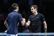 Andy Murray (Great Britain) shakes the hand of Novak Djokovic (Serbia) after winning the Championship Trophy during the final of the Barclays ATP World Tour Finals at the O2 Arena, London, United Kingdom on 20 November 2016. Photo by Phil Duncan.
