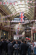 Lunchtime drinkers gather in Leadenhall Market on St George's Day, when 'Englishmen' celebrate their patron saint.