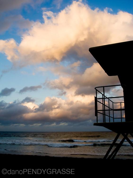 A vacant lifeguard tower overlooks an early morning beach in Encinitas, California.