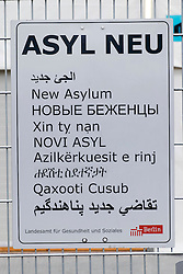 © Licensed to London News Pictures. 18/03/2016. A multi-language sign by The Regional Office for Health and Social Affairs Berlin(LaGeSo) for refugees.  A total of 1.1 million people were registered as asylum-seekers in Germany in 2015, nearly five times the number registered in 2014. More than a third of these, nearly 430,000 people, were those fleeing the protracted civil war in Syria. Berlin, Germany. Photo credit: Ray Tang/LNP