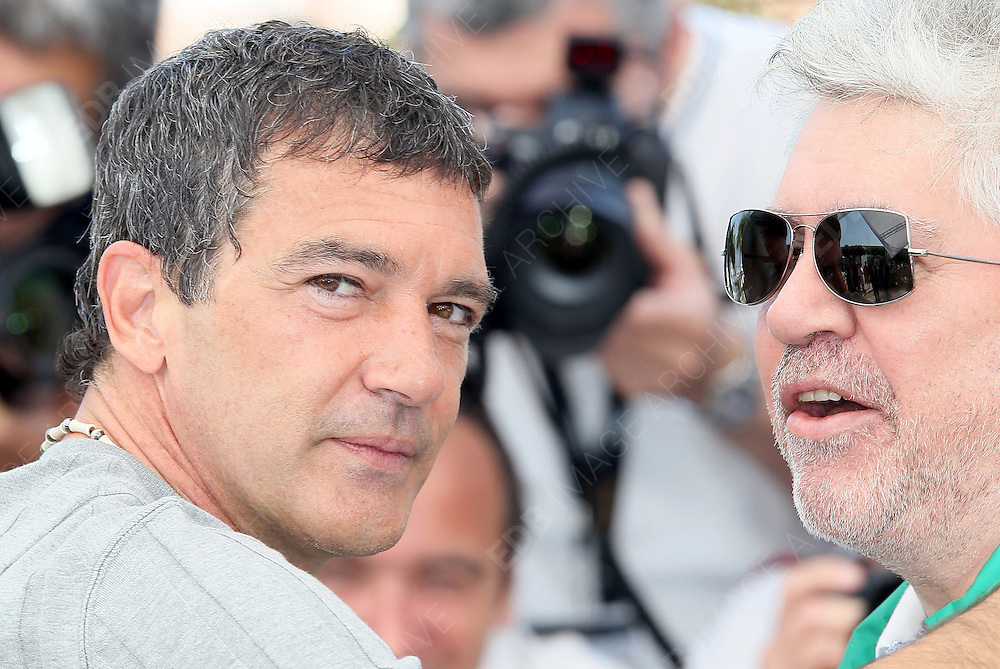 19.MAY.2011. CANNES<br /> <br /> PEDRO ALMODOVAR AND ANTONIO BANDERAS AT THE PHOTOCALL FOR THE SKIN I LIVE AT THE 64TH CANNES INTERNATIONAL FILM FESTIVAL 2011 IN CANNES, FRANCE. <br /> <br /> BYLINE: EDBIMAGEARCHIVE.COM<br /> <br /> *THIS IMAGE IS STRICTLY FOR UK NEWSPAPERS AND MAGAZINES ONLY*<br /> *FOR WORLD WIDE SALES AND WEB USE PLEASE CONTACT EDBIMAGEARCHIVE - 0208 954 5968*