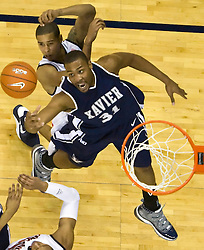 Xavier forward/center Jason Love (31) battles with Virginia guard Sylven Landesberg (15) to grab a rebound.  The #22 ranked Xavier Musketeers defeated the Virginia Cavaliers 84-70 at the John Paul Jones Arena on the Grounds of the University of Virginia in Charlottesville, VA on January 3, 2009.