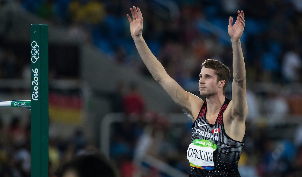 Derek Drouin of Canada wins the Men's high jump competition in Rio de Janeiro on August 16, 2016.
