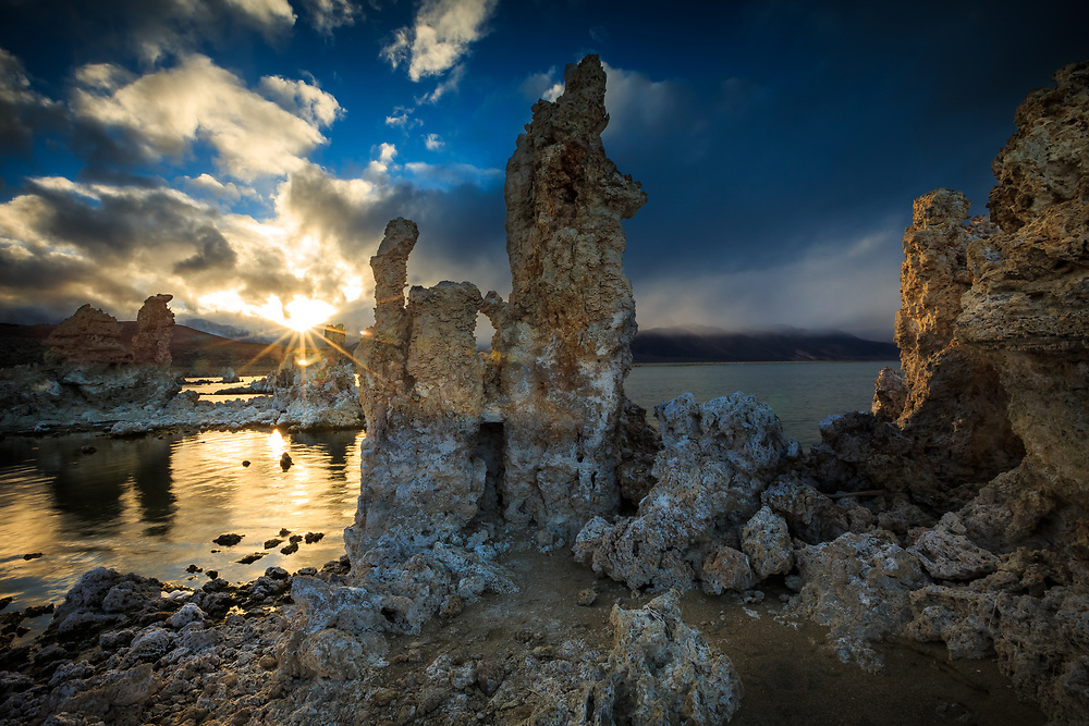 Tufa formations are highlighted at sunset during a clearing winter storm over Mono Lake.
