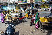 Traffic moves past vendors at a street market in Waragal, Telangana, Indiia, on Sunday, February 10, 2019. Photographer: Suzanne Lee for Safe Water Network