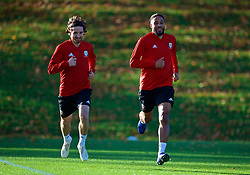 CARDIFF, WALES - Monday, November 12, 2018: Wales' Joe Allen (L) and captain Ashley Williams (R) during a training session at the Vale Resort ahead of the UEFA Nations League Group Stage League B Group 4 match between Wales and Denmark. (Pic by David Rawcliffe/Propaganda)