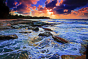 Dramatic sunset over surging surf at Turtle Bay on Oahu's famed north shore, Hawaii