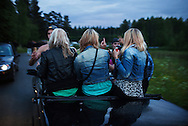 Ungdomar på väg till dansen på Gunnevi. Gunnarskog, juni 2012...Youths on their way to the Gunnevi dance. Gunnarskog, Sweden, June 2012.