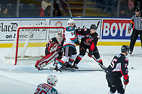 KELOWNA, CANADA - FEBRUARY 20:  Kyle Topping #24 of the Kelowna Rockets is checked by Austin Crossley #6 in front of the net of Taylor Gauthier #35 of the Prince George Cougars during second period on February 20, 2018 at Prospera Place in Kelowna, British Columbia, Canada.  (Photo by Marissa Baecker/Shoot the Breeze)  *** Local Caption ***
