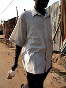A man walks holding a bag of spices in Changugu, a city right on the southern tip of lake Kivu connecting Rwanda to Congo.