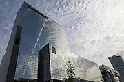 High rise modern glass office block buildings reflecting clouds, Rotterdam, Netherlands