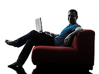 one caucasian man sofa couch computer computing laptop in silhouette isolated on white background