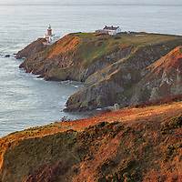 The lighthouse at Howth Headland illuminated by beautiful sunrise light. Howth, Ireland