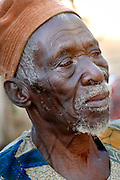 Benin, Djougou November 28, 2006 - Man with tribal scarification on his face. Scarification is used as a form of initiation into adulthood, beauty and a sign of a village, tribe, and clan.