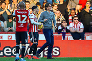 Brentford forward Saïd Benrahma (21) with the match ball  and Brentford Manager Thomas Frank at the end of the game during the EFL Sky Bet Championship match between Brentford and Hull City at Griffin Park, London, England on 23 February 2019.