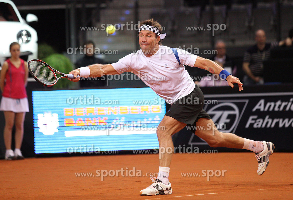 23.04.2012, Porsche Arena, Stuttgart, GER, WTA, Porsche Tennis Grand Prix Stuttgart, im Bild Pat CASH (AUS), Aktion/ Action // during the WTA Porsche Tennis Grand Prix at the Porsche Arena, Stuttgart, Germany on 2012/04/23. EXPA Pictures © 2012, PhotoCredit: EXPA/ Eibner/ Alexander Neis..***** ATTENTION - OUT OF GER *****
