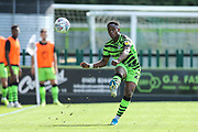 Forest Green Rovers Udoka Godwin-Malife(22) passes the ball forward during the EFL Sky Bet League 2 match between Forest Green Rovers and Colchester United at the New Lawn, Forest Green, United Kingdom on 14 September 2019.