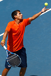 May 24, 2011; Stanford, CA, USA;  Virginia Cavaliers number 3 doubles player Sanam Singh serves against the Southern California Trojans during the finals of the men's team 2011 NCAA Tennis Championships at the Taube Tennis Center.