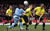 Photo:  Frances Leader.<br /> Watford v Coventry City. Coca Cola Championship. <br /> Vicarage Road Stadium<br /> 05/03/2005<br /> Coventry's Trevor Benjamin and Watford's Jay DeMerit and neil coxbattle for the ball