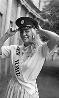 The New York Rose, Kelly Moran a member of the New York Police Departmant(NYPD) tries on a Garda Cap when the Roses visited Leinster House, 21/08/1986 (Part of the Independent Newspapers Ireland/NLI Collection).