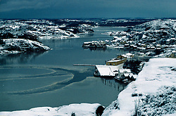 SWEDEN FJALLBACKA JAN04 - General view of dramatic wintery Fjallbacka, with boat tracks on ice.. . jre/Photo by Jiri Rezac. . © Jiri Rezac 2004. . Contact: +44 (0) 7050 110 417. Mobile:  +44 (0) 7801 337 683. Office:  +44 (0) 20 8968 9635. . Email:   jiri@jirirezac.com. Web:    www.jirirezac.com.