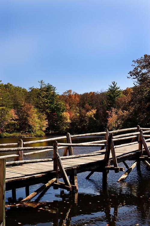 Wooden bridge over lake in autumn