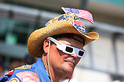 May 27, 2012; Indianapolis, IN, USA; An Indy 500 fan wears the commemorative glasses in honor of Dan Wheldon before the Indy 500 at Indianapolis Motor Speedway. Mandatory credit: Michael Hickey-US PRESSWIRE