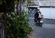 A young boy heads off to school in Chiang Mai Thailand.