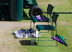 LONDON, ENGLAND - Friday, July 4, 2014: Four pairs of shoes left behind by Grigor Dimitrov (BUL) during the Gentlemen's Singles Semi-Final match on day eleven of the Wimbledon Lawn Tennis Championships at the All England Lawn Tennis and Croquet Club. (Pic by David Rawcliffe/Propaganda)