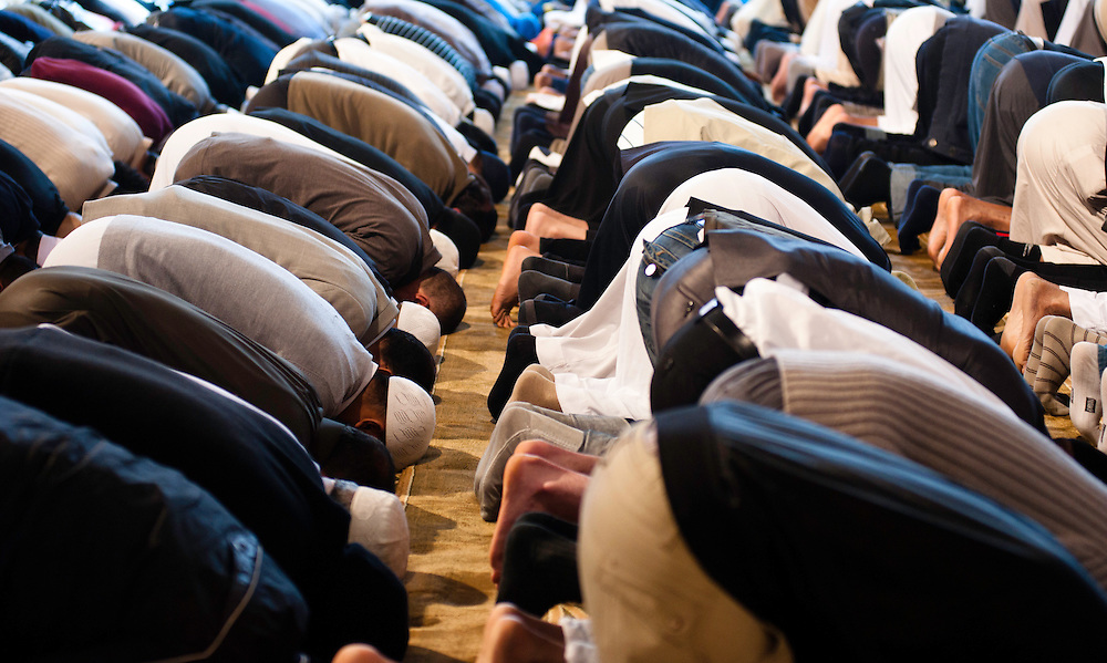 London, UK - 20 July 2012: London's Muslim community prays for the first day of Ramadan in the East London Mosque, the largest in Britain.